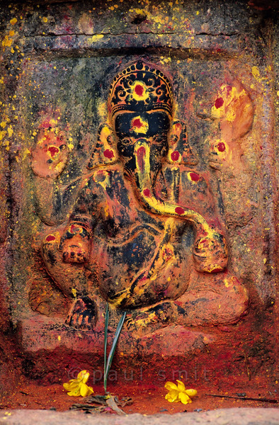 [NEPAL.KATHMANDUVALLEY 27371] 'Ganesh in Lele.'  In the village of Lele, in the Lele Valley south of Patan, this relief of Ganesh can be found. Yellow and red powder has been smeared on the sculpture during puja offerings. Photo Paul Smit.
