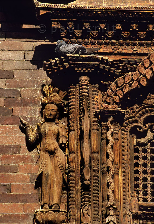 "[NEPAL.KATHMANDUVALLEY 27253] 'Window of Kumari Chowk in Kathmandu.'  	Wood-carved window in the Kumari Chowk, the residence of the city's ""living goddess"". The house of the Kumari is situated on the south side of Kathmandu's Durbar Square. Photo Paul Smit."