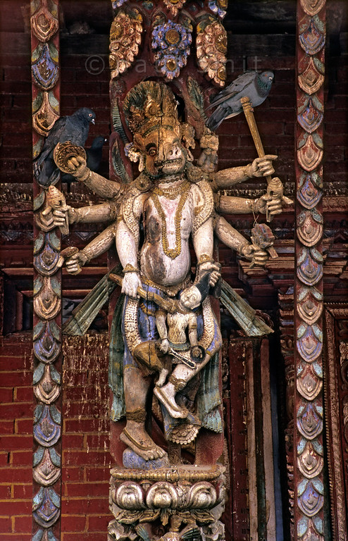 [NEPAL.KATHMANDUVALLEY 27553] 'Varaha the Boar at Changu Narayan.'  	The roof struts of the Changu Narayan Temple show several incarnations in which Vishnu (also called Narayan) destroyed evildoers. Here we see Varaha the Boar (Vishnu's third incarnation) who dived into the ocean to rescue the earth and who battled with the demon Hiranyaksha while he was lifting the earth from the waters. Photo Paul Smit.