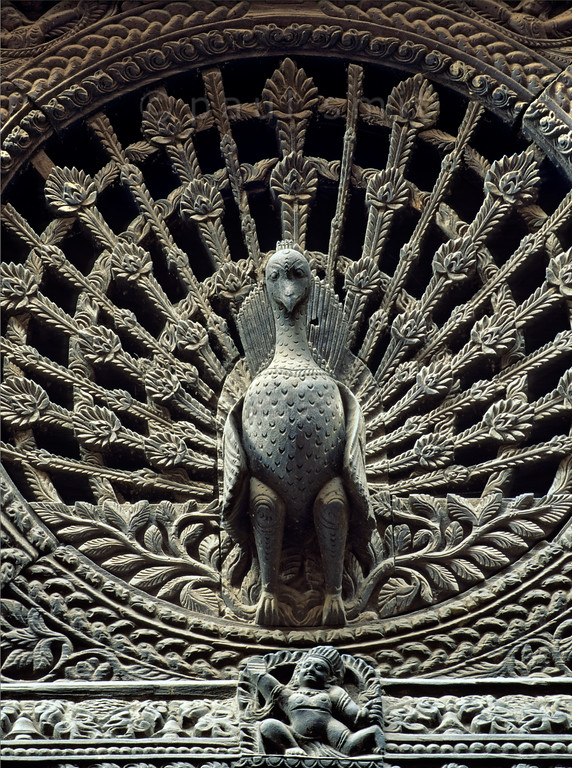 [NEPAL.KATHMANDUVALLEY 27391] 'Peacock window in Bhaktapur.'  The Peacock Window of Bhaktapur's Pujari Math (priests' quarters) is Nepal's most famous piece of woodcarving. The 18th century Pujari Math can be found on Dattatraya Square. Photo Paul Smit.