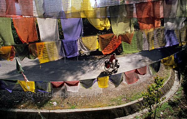 [NEPAL 27611] 'Prayer flags over the Tribhuwan Highway.'  Between Daman and the Simbhanjyang Pass the Tribhuwan Rajpath (highway) snakes its way up past the Shri Rikheshwar Temple. The switchback near the temple passes under a multitude of prayer flags. Photo Mick Palarczyk.