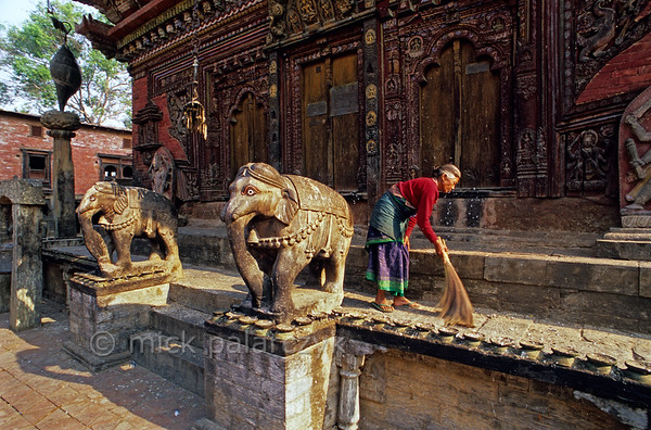 [NEPAL.KATHMANDUVALLEY 27540] 'Elephants at Changu Narayan.'  	The southern entrance of the Vishnu Temple (ca. 1700) at Changu Narayan is guarded by two elephants. Photo Mick Palarczyk.