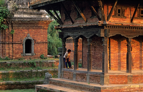 [NEPAL.KATHMANDUVALLEY 27440] 'Temple near Bhaktapur's Chuping Ghat.'  	A small temple complex on the bank of the Hanumante River near Bhaktapur's Chuping Ghat is a favourite spot for the town's youth to spend their time. Photo Paul Smit.