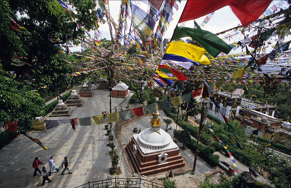[NEPAL.KATHMANDUVALLEY 27244] 'Prayer flags at Manjushri Hill.'  	Near Swayambhu, west of Kathmandu, prayer flags surround the stupa topped shrines at Manjushri Hill. Photo Paul Smit.