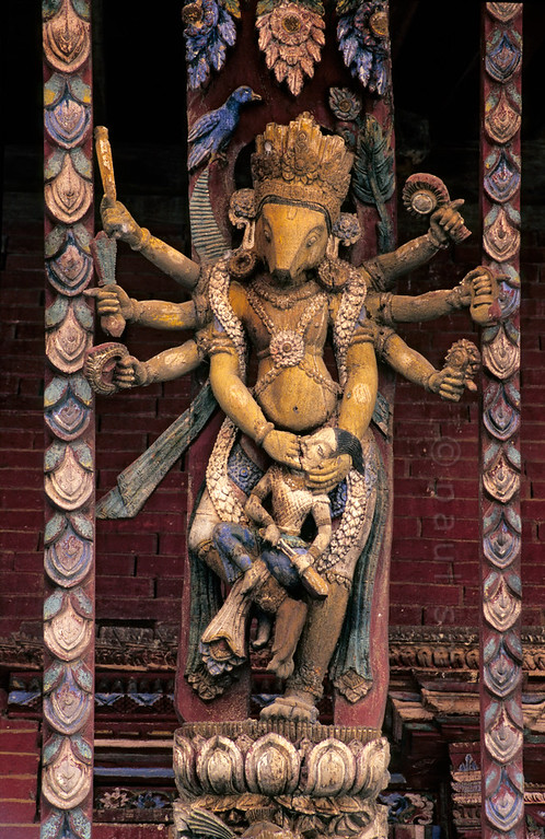 [NEPAL.KATHMANDUVALLEY 27557] 'Roof strut at Changu Narayan.'  	The roof struts of the Changu Narayan Temple show several incarnations in which Vishnu (also called Narayan) destroyed  and (in the future) will destroy evildoers. Here we see Kalki the Horse (Vishnu's tenth incarnation) who at the end of the present age will destroy the enemies of Dharma. Photo Paul Smit.