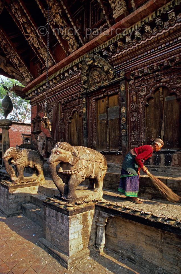 [NEPAL.KATHMANDUVALLEY 27538] 'Elephants at Changu Narayan.'  The southern entrance of the Vishnu Temple (ca. 1700) at Changu Narayan is guarded by two elephants. Photo Mick Palarczyk.