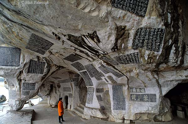 [CHINA.GUANGXI 25.348] 'Thousand Buddhas Cave-1.'  At Guilin the Li River has hollowed out the Thousand Buddhas Cave (Qianfo Dong) in the foot of Fubo Hill, the lime-stone walls of which have been filled with inscription-slabs from the Tang and Song dynasties. Photo Mick Palarczyk.