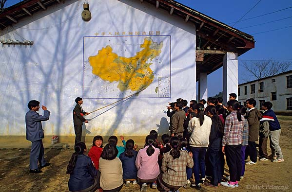 [CHINA.GUANGXI 25.219] 'Out-door lesson.'	 At a school in Daning, north-east of Hexian, teachers are giving an out-door lesson in Chinese geography. Photo Mick Palarczyk.
