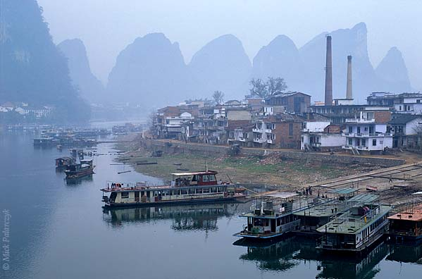 [CHINA.GUANGXI 25.379] 'Yangshuo.' At Yangshuo the Li River is lined by cone-shaped lime-stone mountains. Photo Mick Palarczyk.