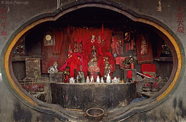 [CHINA.GUANGXI 25.248] 'Road-side shrine.'	 Small road-side shrine at Daning, north-east of Hexian. Photo Mick Palarczyk.