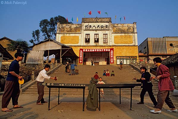 [CHINA.GUANGXI 25.321] 'Ping-pong.'	 In the last rays of the evening sun villagers are playing ping-pong on a square in Tongan, 45 km south-east of Yangshuo. Photo Mick Palarczyk.