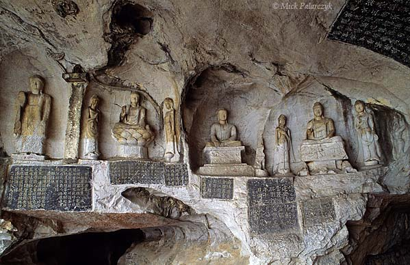 [CHINA.GUANGXI 25.351] 'Thousand Buddhas Cave-2.'  	At Guilin the Li River has hollowed out the Thousand Buddhas Cave (Qianfo Dong) in the foot of Fubo Hill, the lime-stone walls of which have been filled with inscription-slabs from the Tang and Song dynasties. Photo Mick Palarczyk.
