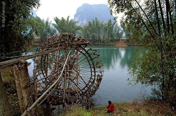 [CHINA.GUANGXI 25.401] 'Irrigation wheel.'	 A water-powered irrigation wheel south of Yangshuo is used to lift water from the Yulong River to nearby rice fields. Photo Mick Palarczyk.
