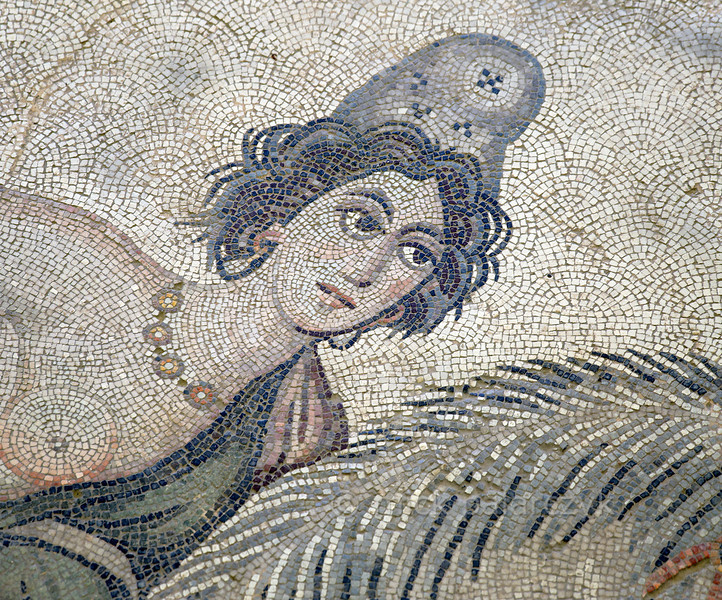 """[TURKEY.EAST 29275] 'Melanippe, Amazon in Byzantine mosaic in Urfa.'  Wearing a Phrygian cap, the Amazon Melanippe is part of a large hunting scene with several animals and other Amazons. The warrior queen from Greek Mythology is typically represented with one breast, as the other one has been removed to prevent it getting in the way in battle. The 5/6 th century floor mosaic can be found in the """"Villa of the Amazons"""", a palatial house, that probably belonged to an important administrator of the Eastern Roman (Byzantine) Empire, who lived in Edessa (nowadays called Urfa). The remains of the villa were discovered in 2006 near the center of Urfa. Photo Mick Palarczyk."""