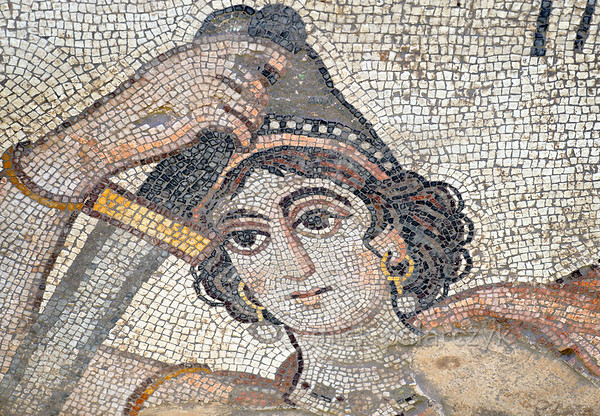 """[TURKEY.EAST 29269] 'Hippolyte, Amazon in Byzantine mosaic in Urfa.'  Wearing a Phrygian cap, the Amazon Hippolyte (a warrior queen in Greek Mythology) is brandishing her sword in a mosaic floor that depicts a hunting scene. The 5/6 th century mosaic can be found in the """"Villa of the Amazons"""", a palatial house, that probably belonged to an important administrator of the Eastern Roman (Byzantine) Empire, who lived in Edessa (nowadays called Urfa). The remains of the villa were discovered in 2006 near the center of Urfa. Photo Mick Palarczyk."""