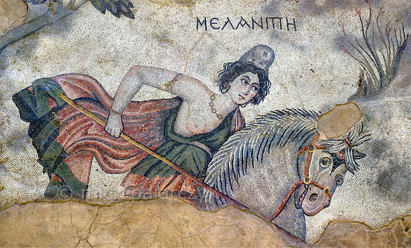 """[TURKEY.EAST 29272] 'Melanippe, Amazon in Byzantine mosaic in Urfa.'  Wearing a Phrygian cap and red robe, the Amazon Melanippe is thrusting her lance towards a lion (not in picture) in a mosaic floor that depicts a hunting scene. The warrior queen from Greek Mythology is typically represented with one breast, as the other one has been removed to prevent it getting in the way in battle. The 5/6 th century mosaic can be found in the """"Villa of the Amazons"""", a palatial house, that probably belonged to an important administrator of the Eastern Roman (Byzantine) Empire, who lived in Edessa (nowadays called Urfa). The remains of the villa were discovered in 2006 near the center of Urfa. Photo Mick Palarczyk."""