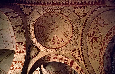 [TURKEY.CENTRAL 26809 'Saint Barbara Chapel-1.'  	The domes of the St. Barbara Chapel have been cut out of the volcanic rock east of the Cappadocian village of Göreme. Its abstract decorations date from the iconoclastic period (725- 842 AD) when images of god or saints were not allowed. The cave church is part of a monastic settlement that was occupied from the 4th till the 13th century and is now situated in the Göreme Open-air Museum. Photo Mick Palarczyk.