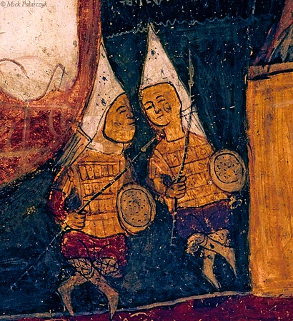 [TURKEY.CENTRAL 26907 'Soldiers guarding Christ's tomb.'  	Two soldiers, sitting beside the tomb of Christ, seem to be leisurely chatting away in this 13th century frescoe adorning the ceiling of the St. Johns Church (Karsi Kilise). The church, which is carved into a cone of soft volcanic tuff, can be found near the Cappadocian town of Gülsehir. Photo Mick Palarczyk.