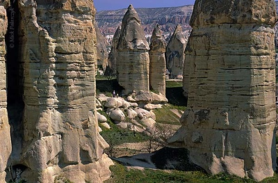 [TURKEY.CENTRAL 26800 'Fairy chimneys in Görkün Valley-6.'  The Görkün Valley south of the Cappadocian village of Göreme boasts some of the most spectacular fairy chimneys. The pillars consist of tuff (consolidated volcanic ash) that has been protected from rain erosion by a cap of harder more solidified ash (ignimbrite). Photo Mick Palarczyk.