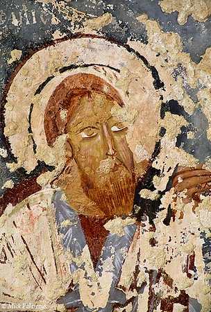 [TURKEY.CENTRAL 26812 'Saint in El Nazar Church.'  	This 11th century portrait of a saint can be found in the El Nazar Church, which is carved out of a conical rock formation ('fairy chimney') to the east of the Cappadocian village of Göreme. Photo Mick Palarczyk.