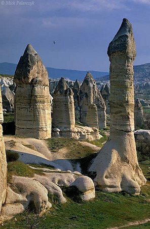 [TURKEY.CENTRAL 26795 'Fairy chimneys in Görkün Valley-3.'  	The Görkün Valley south of the Cappadocian village of Göreme boasts some of the most spectacular fairy chimneys. The pillars consist of tuff (consolidated volcanic ash) that has been protected from rain erosion by a cap of harder more solidified ash (ignimbrite). Photo Mick Palarczyk.