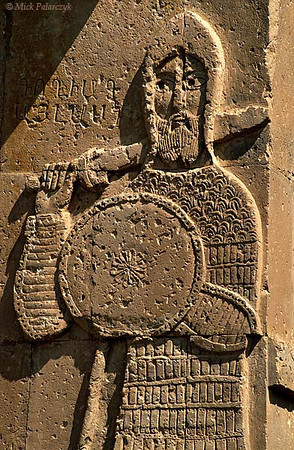 [TURKEY.EAST 27930] 'Goliath on Akdamar Island.'  	Goliath is about to deliver a blow with his sword on the southern facade of the 10th century Armenian Cathedral of the Holy Cross on Akdamar, a small island in Lake Van. In accordance with the biblical tale, he wears a helmet of brass and a coat of mail. Photo Mick Palarczyk.