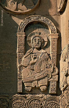 [TURKEY.EAST 27938] 'Figure of Christ on Akdamar Island.'  The enthroned figure of Christ is holding a book of Gospels in his left hand while his right hand is raised in blessing. Relief adorning the southern facade of the 10th century Armenian Cathedral of the Holy Cross on Akdamar, a small island in Lake Van. Photo Mick Palarczyk.