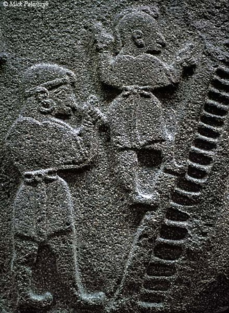 [TURKEY.CENTRAL 26991 'Hittite acrobats.'  	Acrobats are performing an act with a ladder on this relief from Alacahöyük, a Hittite site near the Hittite capital of Hattusha, north of Yozgat. The relief, dating from about the 14th  century BC, is currently in the Museum of Anatolian Civilizations in Ankara. Photo Mick Palarczyk.
