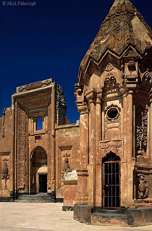 [TURKEY.EAST 27970] 'Second court of the Ishak Pasha Palace.'  The Ishak Pasha Palace, south of Dogubayazit, was built in the 17th and 18th century by a family of Kurdish chieftains who grew rich by controlling the traffic on the trade route between Iran and Trabzon. Here we see the second court of the palace with the entrance to the family tomb on the right. The architecture of the complex is a stunning amalgam of Seljuk, Ottoman, Georgian, Persian and Armenian styles. Photo Mick Palarczyk.