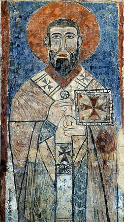 [TURKEY.EAST 27950] 'Saint with red nimbus on Akdamar Island.'  	A saint with a red nimbus is - somewhat awkwardly - holding a book of Gospels in his left hand. Fresco in the interior of the 10th century Armenian Cathedral of the Holy Cross on Akdamar, a small island in Lake Van. Photo Mick Palarczyk.