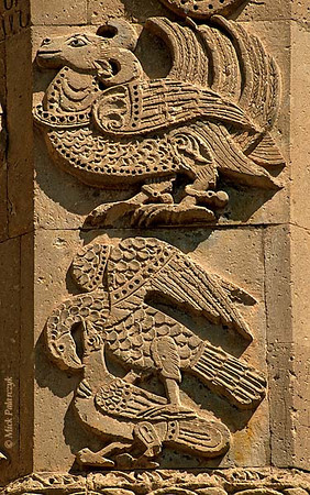 [TURKEY.EAST 27931] 'Birds on Akdamar Island.'  	Real and mythical birds adorn the southern facade of the 10th century Armenian Cathedral of the Holy Cross on Akdamar, a small island in Lake Van. Below, an eagle has set down on a pigeon, its talons grasping the defenseless bird by the neck and wing. Above that a fantastic creature has the body of a bird and the head of a horned goat. Photo Mick Palarczyk.
