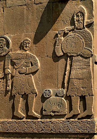 [TURKEY.EAST 27929] 'David and Goliath on Akdamar Island.'  	David is about to launch a stone with his sling towards his opponent Goliath on the southern facade of the 10th century Armenian Cathedral of the Holy Cross on Akdamar, a small island in Lake Van. In accordance with the biblical tale, Goliath wears a helmet of brass and a coat of mail. David has his bag with stones hanging from a strap across his breast. Photo Mick Palarczyk.