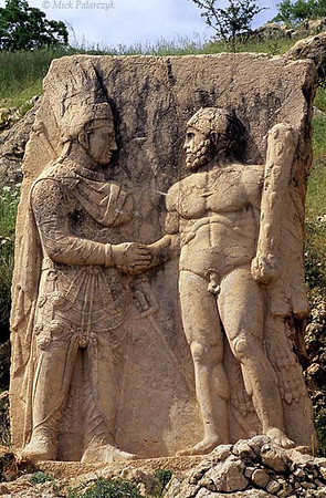 [TURKEY.EAST 27873] 'Mithradates shaking hands with Hercules-1.'  At Arsameia, the ruined capital of the Commagene kingdom in the first century BC, a relief shows king Mithradates Kallinikos (left) shaking hands with Hercules, who in Commagene also represented the persian god Artagnes. Commagene was a small independent kingdom squeezed between the Roman Empire and the Parthian (Persian) kingdom, east of modern Adiyaman. Photo Mick Palarczyk.