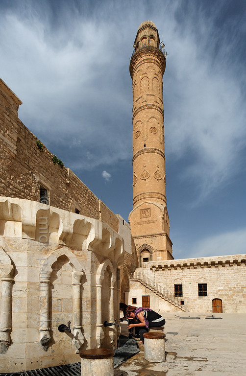 [TURKEY.EAST 29151] 'Courtyard of Great Mosque in Mardin.'  	The courtyard of the 11th century Great Mosque (Ulu Cami) in Mardin (southeastern Turkey) is dominated by a cylindrical minaret. Photo Mick Palarczyk.