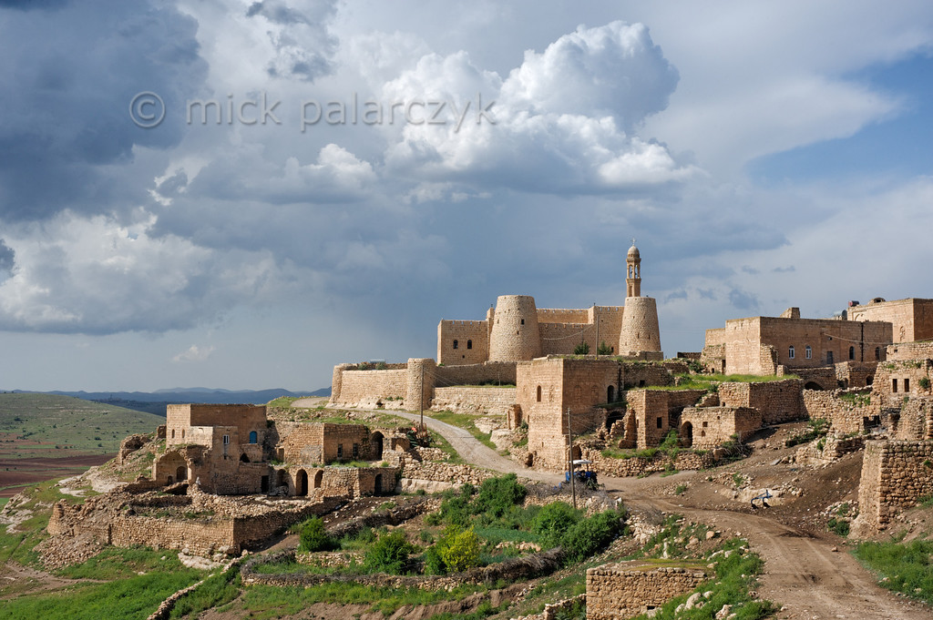 [TURKEY.EAST 29216] 'Mor Hadbschabo Church in Gülgöze.'  The fortlike Syrian Orthodox Mor Hadbschabo Church towers above the village of Gülgöze (also called Ainwardo), 10 km east of Midyat in a remote corner of the Tur Abdin Plateau, a region which is known as the heartland of the Syrian Orthodox Church. The village has three Syrian Orthodox churches and was first mentioned on the 13th century. Photo Mick Palarczyk.