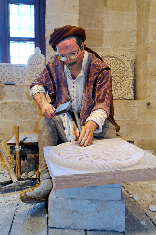 [TURKEY.EAST 29132] 'Stonecutter in Mardin city Museum.'  	Mardin, in southeastern Turkey, is famous for the beautiful ornate carving on the outside of its buildings. A stonecutter, working on a slab of limestone, is portrayed in the Mardin City Museum. Photo Mick Palarczyk.