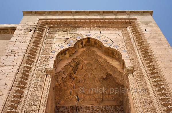 [TURKEY.EAST 29149] 'Portal of Zinciriye Medresesi in Mardin.'  	The 14th century Zinciriye Medresesi (Islamic school) in Mardin (southeastern Turkey) has an exquisitely carved entrance portal in Seljuk style. Mardin served as a capital of the Artuqid dynasty between the 12 the and 15th centuries, which resulted in much of the Islamic heritage visible in the city today. Photo Mick Palarczyk.