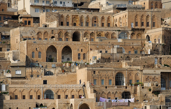 [TURKEY.EAST 29130] 'Old houses of Mardin.'  	The old town of Mardin in southeastern Turkey is famous for its houses built of honey coloured limestone, many of which are decorated by ornate carving. The streets of Mardin are cascading from a steep hill which overlooks the Mesopotamian plains. Photo Mick Palarczyk.