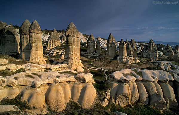 [TURKEY.CENTRAL 26792 'Fairy chimneys in Görkün Valley-2.'  The Görkün Valley south of the Cappadocian village of Göreme boasts some of the most spectacular fairy chimneys. The pillars consist of tuff (consolidated volcanic ash) that has been protected from rain erosion by a cap of harder more solidified ash (ignimbrite). Photo Mick Palarczyk.