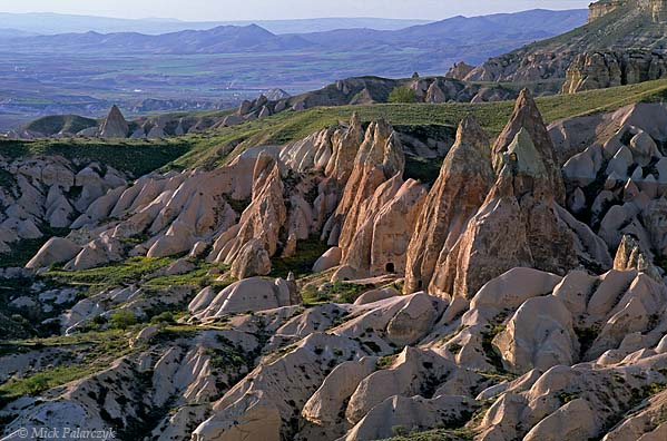 [TURKEY.CENTRAL 26877 'Church of the Cross-1.'  	An ensemble of tuff cones with rose base and grey-yellow top, at the head of the Cappadocian Güllüdere Valley, contains the Byzantine Church of the Cross (Hacli Kilise). Photo Mick Palarczyk.