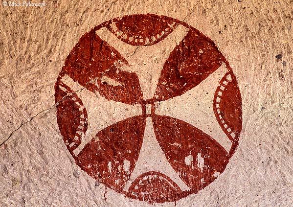 [TURKEY.CENTRAL 26813 'Circular cross.'  A small cave church in the Kiliclar Valley, east of the Cappadocian village of Göreme, bears a circular cross on its wall. Photo Mick Palarczyk.