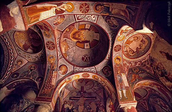 [TURKEY.CENTRAL 26804 'Domes of the Elmali Church-1.'  The nine domes of the Byzantine Elmali Church have been cut out of the volcanic rock east of the Cappadocian village of Göreme. Its frescoes date from the 11th century. This cave church is part of a monastic settlement that was occupied from the 4th till the 13th century and is now situated in the Göreme Open-air Museum. Photo Mick Palarczyk.