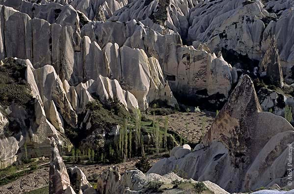 [TURKEY.CENTRAL 26893 'Kizilcukur Valley.'  In the Cappadocian Kizilcukur Valley, northeast of Göreme, small vineyards are surrounded by razor sharp ridges of white tuff. The tuff was deposited in the form of ash by nearby volcanos between 11 and 3 million years ago. Photo Mick Palarczyk.