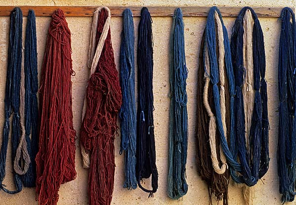 [TURKEY.CENTRAL 26783] 'Yarns for carpet weaving.'  	Yarns hanging on display in the former caravanserai of Mustafapasa have been coloured with pigments extracted from flowers, leafs and bark. The wool yarns are locally used for weaving carpets. Photo Mick Palarczyk.
