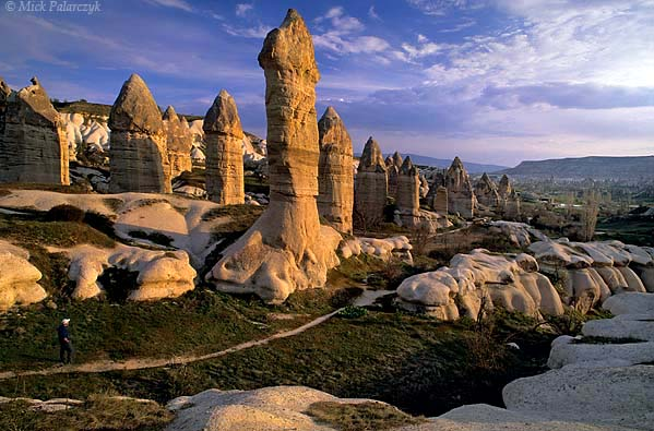 [TURKEY.CENTRAL 26790 'Fairy chimneys in Görkün Valley-1.'  	The Görkün Valley south of the Cappadocian village of Göreme boasts some of the most spectacular fairy chimneys. The pillars consist of tuff (consolidated volcanic ash) that has been protected from rain erosion by a cap of harder more solidified ash (ignimbrite). Photo Mick Palarczyk.