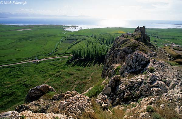 [TURKEY.EAST 27961] 'The Rock of Van.'  The Rock of Van, on the shore of Lake Van and three kilometer west of the modern city of Van, has been used as a stronghold by the Urartians ( ca. 1000 BC), Armenians and Ottomans. Down, on the left, are the overgrown foundations of the old city of Van which was destroyed during the upheavals of World War I. Photo Mick Palarczyk.