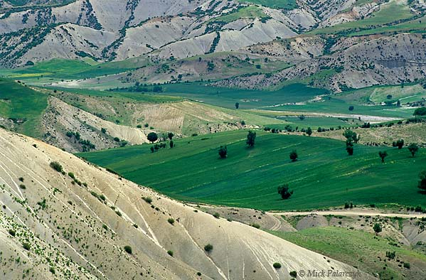 [TURKEY.EAST 27890] 'Valley near Atmali.'  On the southern slopes of the Taurus mountain range this green-white lateral valley of the Euphrates can be found near Atmali, west of Adiyaman. Photo Mick Palarczyk.