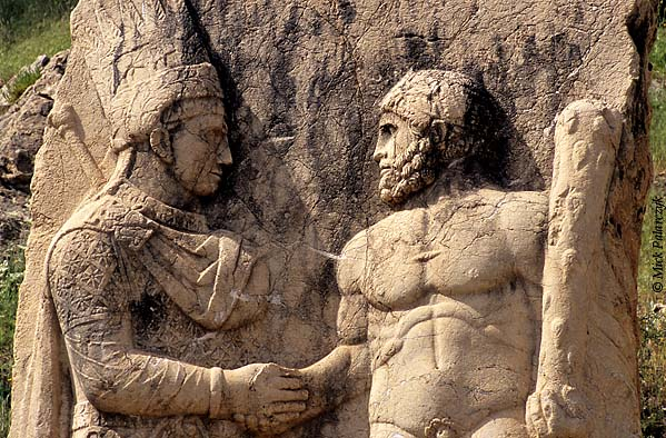 [TURKEY.EAST 27874] 'Mithradates shaking hands with Hercules-2.'  	At Arsameia, the ruined capital of the Commagene kingdom in the first century BC, a relief shows king Mithradates Kallinikos (left) shaking hands with Hercules, who in Commagene also represented the persian god Artagnes. Commagene was a small independent kingdom squeezed between the Roman Empire and the Parthian (Persian) kingdom, east of modern Adiyaman. Photo Mick Palarczyk.