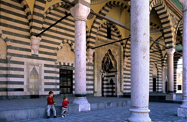 [TURKEY.EAST 27897] 'Behram Pasha Mosque in Diyarbakir.'  The the entrance portal of the Behram Pasha Mosque (1572) in the old centre of Diyarbakir has been decorated with alternating bands of black basalt and white sandstone. Photo Mick Palarczyk.