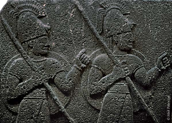 [TURKEY.CENTRAL 26986 'Hittite soldiers.'  	Neo Hittite soldiers with spears carry their shields on their back on a basalt relief that was once part of the Royal Buttress in the Hittite city of Carchemish. The relief, dating from the 8th century BC, is currently in the Museum of Anatolian Civilizations in Ankara. Photo Mick Palarczyk.